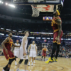Dec 12, 2014; New Orleans, LA, USA; Cleveland Cavaliers forward LeBron James (23) dunks against the New Orleans Pelicans during the first quarter of a game at the Smoothie King Center. The Pelicans defeated the Cavaliers 119-114. Mandatory Credit: Derick E. Hingle-USA TODAY Sports