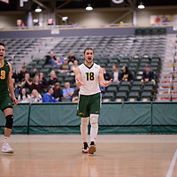 2nd year libero Dryden Wall (18) of the Regina Cougars in action during Men's Volleyball home game on February 2 at Centre for Kinesiology, Health and Sport. Credit: Arthur Ward/Arthur Images
