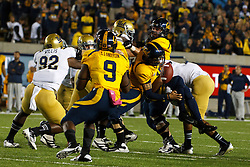 BERKELEY, CA - OCTOBER 06: Quarterback Zach Maynard #15 of the California Golden Bears fumbles the ball after being hit by linebacker Anthony Barr #11 of the UCLA Bruins (right) during the first quarter at California Memorial Stadium on October 6, 2012 in Berkeley, California. The California Golden Bears defeated the UCLA Bruins 43-17. (Photo by Jason O. Watson/Getty Images) *** Local Caption *** Zach Maynard; Anthony Barr