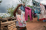 Coffee farmer Virginia Wambuga hangs clothes to dry outside  her home in Nyeri, Kenya. Keurig Green Mountain  supports Kenyan coffee farmers with assistance by providing dairy goats, banana tissue culture plants, access to financial services through the formation of Savings and Internal Lending Communities and training through Catholic Relief Services and Caritas Nyeri in inter-cropping and farming. Virginia has been battling tuberculosis the assistance she gets from the project has helped to rebuild her health and pay for medical fees. Sara A. Fajardo/Catholic Relief Services
