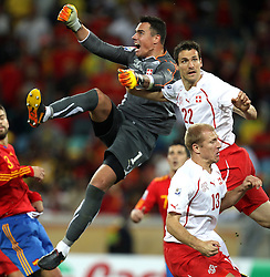 Switzerland goalkeeper Diego BENAGLIO, Mario EGGIMANN and Stephane GRICHTING defend during the 2010 FIFA World Cup South Africa Group H match between Spain and Switzerland at Durban Stadium on June 16, 2010 in Durban, South Africa.