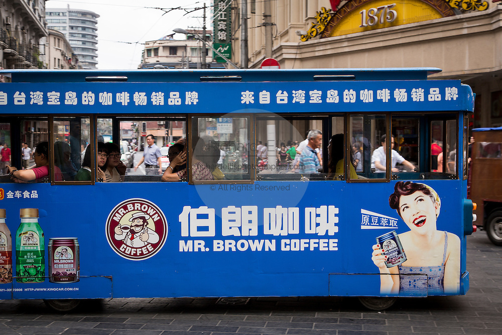 Tram on Nanjing East Road in Shanghai, China.
