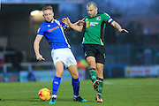 Callum Camps challenged by Steven Davies during the EFL Sky Bet League 1 match between Rochdale and Scunthorpe United at Spotland, Rochdale, England on 10 December 2016. Photo by Daniel Youngs.