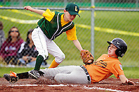 Lakeland All Star's Colin Rose tags Sheldon Sloane from the Post Falls All Star's out at home during the Legion Baseball District 1 9-10 tournament Thursday at Lion's Club Field in Rathdrum.