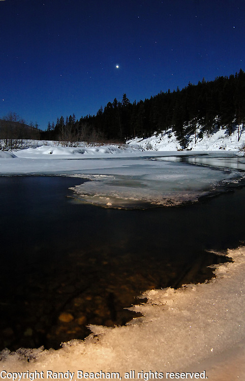Yaak River and venus in winter. Yaak Valley in the Kootenai National Forest, Purcell Mountains, northwest Montana
