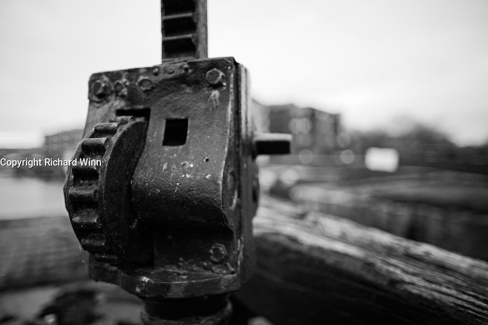 Closeup up view of the gearing that opens the lock gate at the entrance to  Bridgwater Key, using selective focus to isolate it from the bacground.