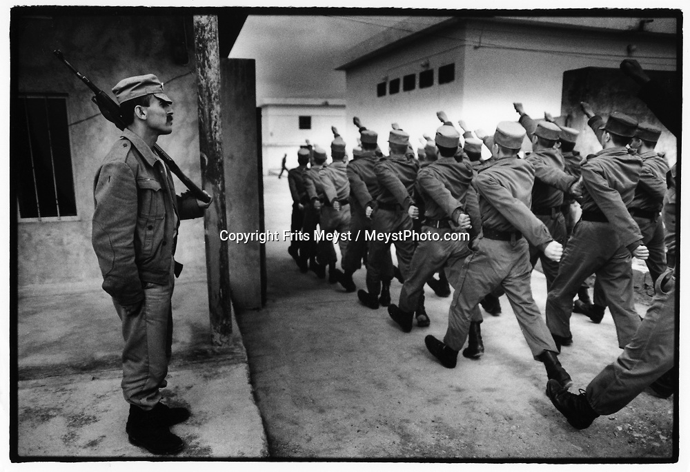 QALA CHUALAN, KURDISTAN, IRAQ, 1994.  Students march at the Kurdish Military Academy. The Military academy was an effort of the PUK and KDP to create a regular army and thus get recognition as an independent state by the international community. The academy broke up in 1995 after fighting between KDP an PUK broke out. ©Photo by Frits Meyst/NewsImages