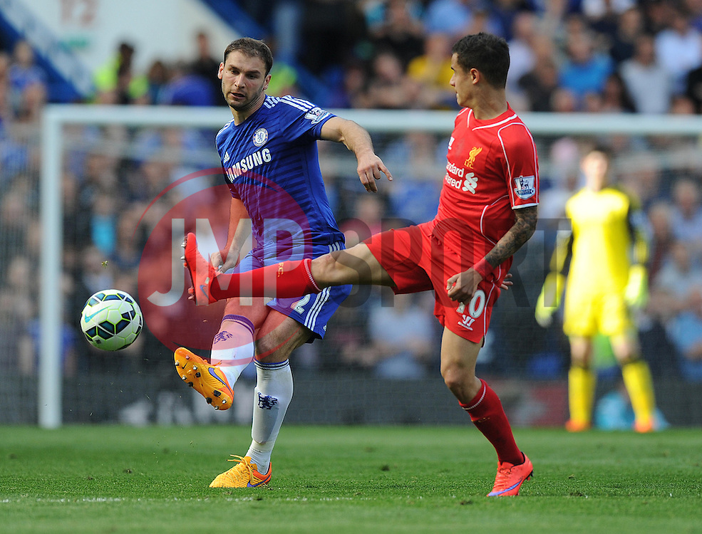 Chelsea's Branislav Ivanovic passes the ball away from Liverpool's Philippe Coutinho - Photo mandatory by-line: Alex James/JMP - Mobile: 07966 386802 - 10/05/2015 - SPORT - Football - London - Stamford Bridge - Chelsea v Liverpool - Barclays Premier League