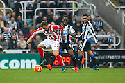 Stoke City Forward Marko Arnautovic holds up Newcastle United Defender Vurnon Anita  during the Barclays Premier League match between Newcastle United and Stoke City at St. James's Park, Newcastle, England on 31 October 2015. Photo by Craig McAllister.