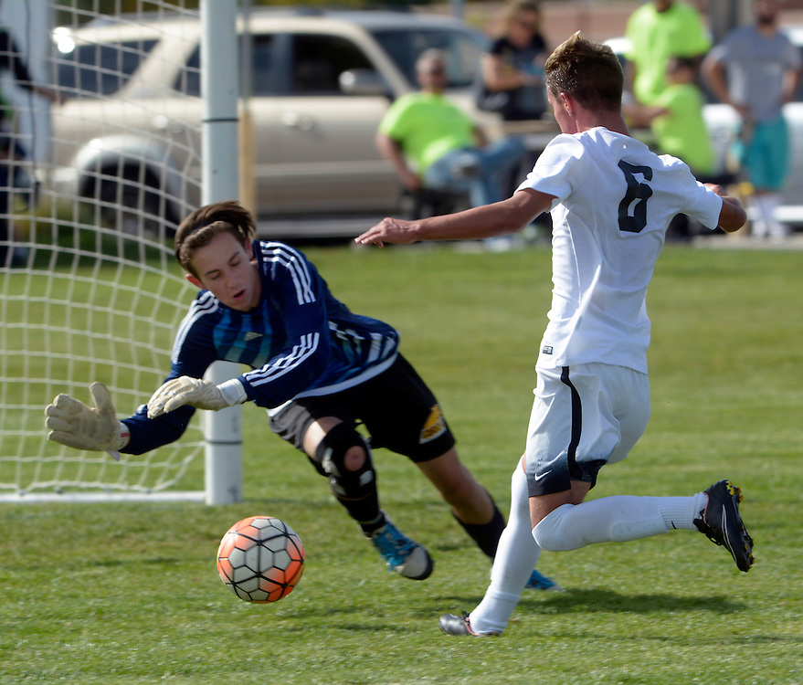 gbs092816n/SPORTS -- Volcano Vista's Zachary Lemasters, 6, kicks a goal past Cibola goal keeper Gage Washburn at Volcano Vista on Wednesday, September 28, 2016. (Greg Sorber/Albuquerque Journal)