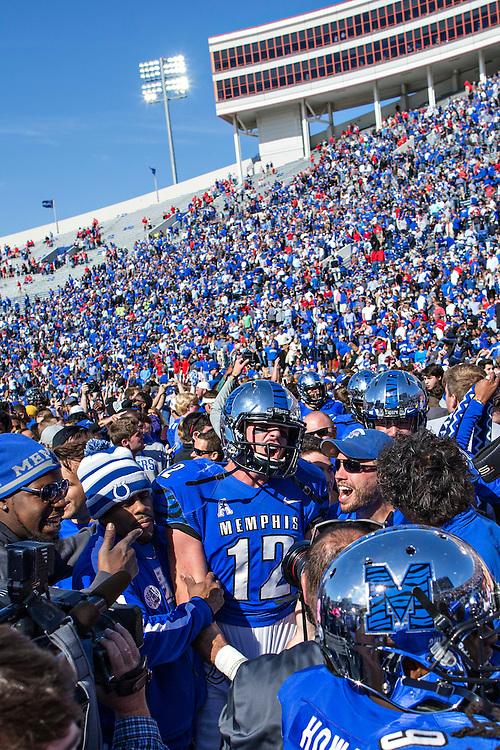 MEMPHIS, TN - OCTOBER 17:  Paxton Lynch #12 of the Memphis Tigers celebrates with fans after a game against the Ole Miss Rebels at Liberty Bowl Memorial Stadium on October 17, 2015 in Memphis, Tennessee.  The Tigers defeated the Rebels 37-24.  (Photo by Wesley Hitt/Getty Images) *** Local Caption *** Paxton Lynch