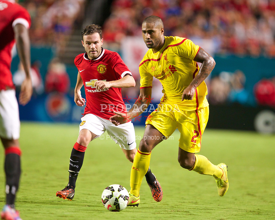 MIAMI, USA - Monday, August 4, 2014: Liverpool's Glen Johnson in action against Manchester United's Juan Mata during the International Champions Cup Final match at the SunLife Stadium on day fifteen of the club's USA Tour. (Pic by David Rawcliffe/Propaganda)