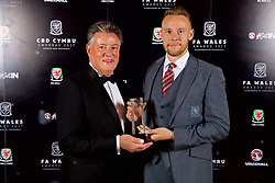 CARDIFF, WALES - Monday, October 2, 2017: FAW Player of the Year Chris Gunter with his award with Vauxhall PR Director Denis Chick during the FAW Awards Dinner at the Hensol Castle. (Pic by David Rawcliffe/Propaganda)