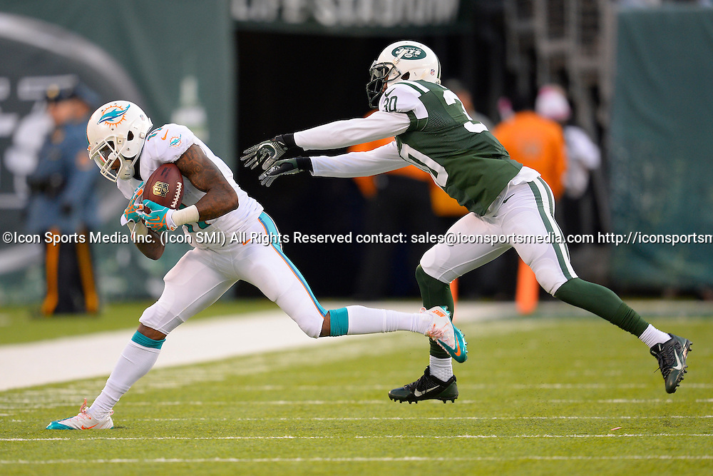 December 1, 2013: Miami Dolphins wide receiver Mike Wallace (11) makes a catch as New York Jets cornerback Darrin Walls (30) defends during the second half of a NFL AFC East matchup between the Miami Dolphins and the New York Jets at MetLife Stadium in East Rutherford, NJ The Dolphins defeated the Jets 23-3.