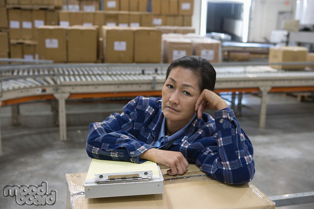 Bored woman in distribution warehouse