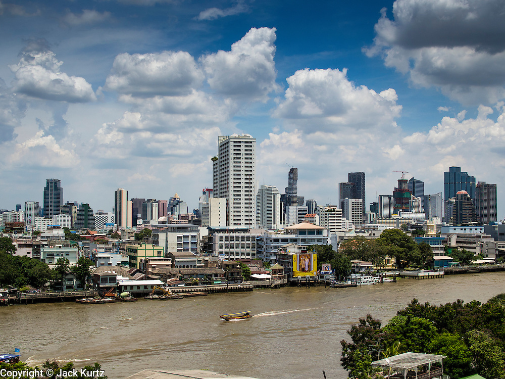 24 AUGUST 2014 - BANGKOK, THAILAND: The skyline of Bangkok seen from the Chee Chin Chor pagoda in Thonburi. The Chao Phraya River is in the foreground. Chee Chin Khor Moral Up-Lifting for Benefiction Foundation in a Chinese style temple on the Thonburi side of the Chao Phraya River in Bangkok. It blends aspects of Taoism, Buddhism (both Theravada and Mahayana), Islam, and Christianity religious traditions. Members of the temple perform community services throughout Bangkok.       PHOTO BY JACK KURTZ