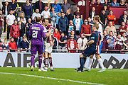 Heated foul during the Ladbrokes Scottish Premiership match between Heart of Midlothian and Kilmarnock at Tynecastle Stadium, Gorgie, Scotland on 3 October 2015. Photo by Craig McAllister.