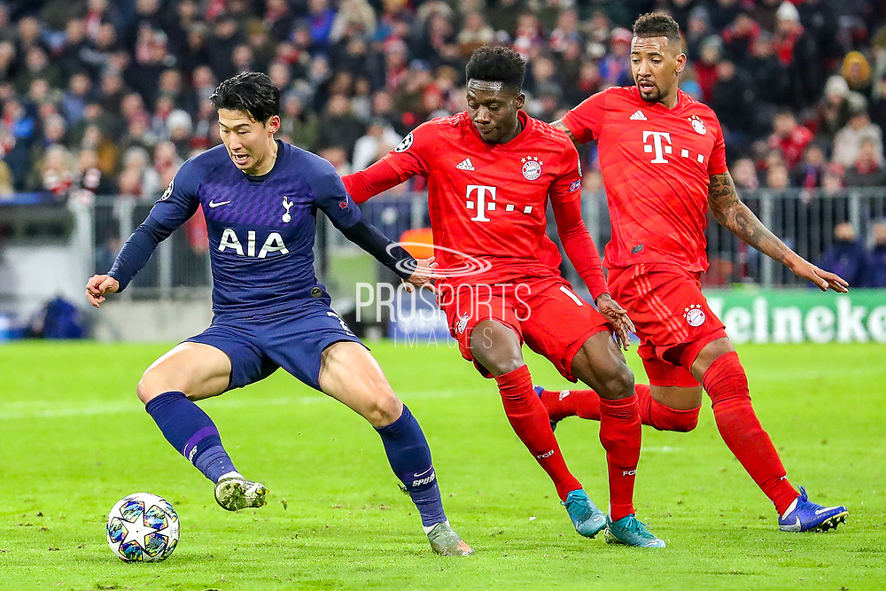 Tottenham Hotspur forward Heung-Min Son (7) tussles with Bayern Munich midfielder Alphonso Davies (19) during the Champions League match between Bayern Munich and Tottenham Hotspur at Allianz Arena, Munich, Germany on 11 December 2019.