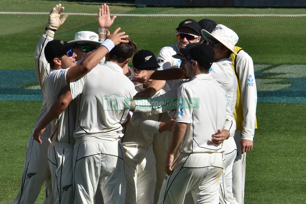 March 26, 2018 - Auckland, Auckland, New Zealand - Trent Boult of Blackcaps is congratulated by teammates taking wicket of Moeen Ali of England during Day Five of the First Test match between New Zealand and England at Eden Park in Auckland on Mar 26, 2018. (Credit Image: © Shirley Kwok/Pacific Press via ZUMA Wire)