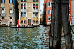 Couple on a balcony, Grand Canal, Accademia, Venice, Italy.<br />