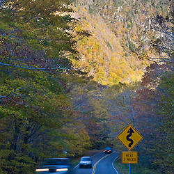 A narrow road (VT 108) winds its way through Smuggler's Notch near Stowe, Vermont.  Smuggler's Notch State Park. Fall.