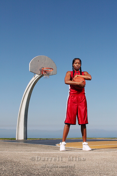 Model: Lakreshia Hart poses on a basketball court.<br /> <br /> Photo Credit: Darrell Miho<br /> &copy; Darrell Miho