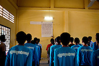 Drug abusers recite a prayer at Orkas Khnom, or My Chance, a government-run facility where youth and young men are brought here by their families or by arrest from police to be re-educated from drug addiction, just outside Phnom Penh, Cambodia, on Tuesday, May 11, 2010.