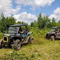 2 Polaris Rzr 1000's riding under beautiful blue cloudy sky, Polaris, rzr, blue sky, clouds, grass, bushes, atv, utv, sxs, ohrv, orv, trail riding, hobby, adventure, sports, therapy, Click Stock Photography