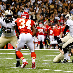 Aug 9, 2013; New Orleans, LA, USA; New Orleans Saints kicker Garrett Hartley (5) kicks a field goal during the second quarter of a preseason game against the Kansas City Chiefs at the Mercedes-Benz Superdome. Mandatory Credit: Derick E. Hingle-USA TODAY Sports