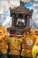 Carrying a Chinese deity on a palanquin through Taipei streets.