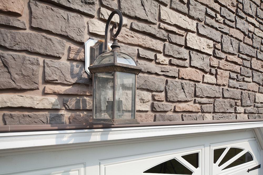 6370_Yellow_Rose stone siding exterior of house garage