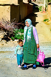 A woman taking her child to nursery in Tamtetoucht, Morocco<br /> <br /> (c) Andrew Wilson | Edinburgh Elite media