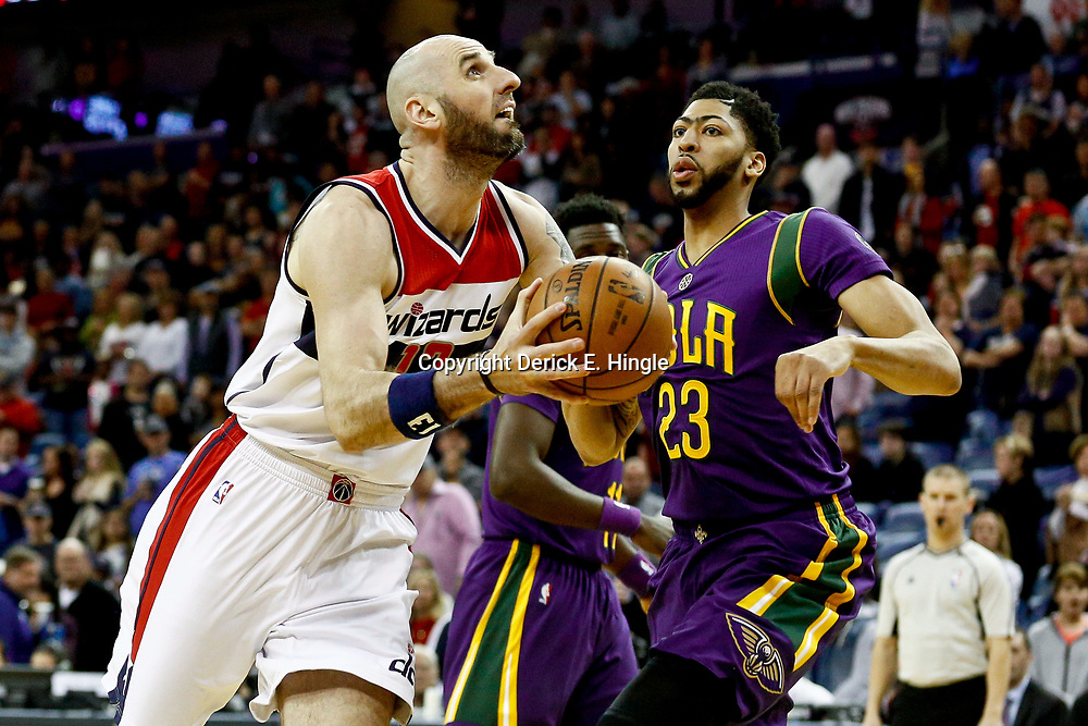Jan 29, 2017; New Orleans, LA, USA; Washington Wizards center Marcin Gortat (13) drives past New Orleans Pelicans forward Anthony Davis (23) during the first quarter of a game at the Smoothie King Center. Mandatory Credit: Derick E. Hingle-USA TODAY Sports