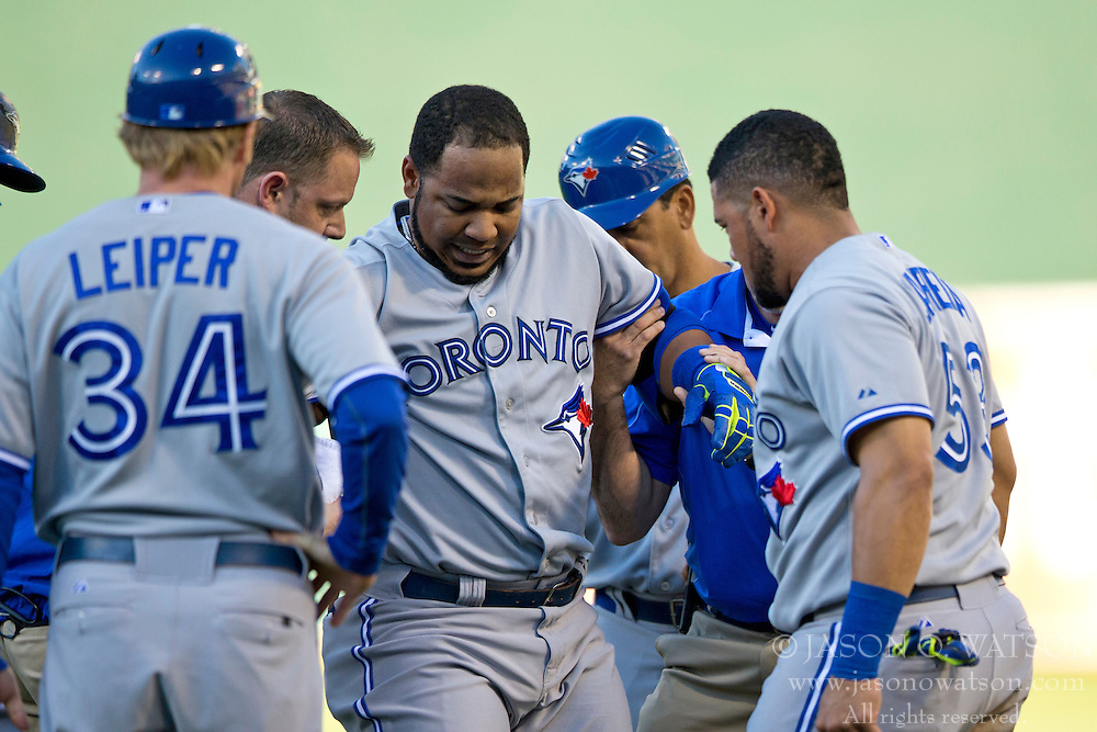 OAKLAND, CA - JULY 05:  Edwin Encarnacion #10 of the Toronto Blue Jays is assisted off the field after sustaining an injury during the first inning against the Oakland Athletics at O.co Coliseum on July 5, 2014 in Oakland, California. (Photo by Jason O. Watson/Getty Images) *** Local Caption *** Edwin Encarnacion