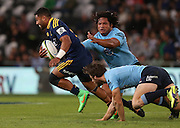 Highlanders Lima Sopoaga makes a break against the Waratahs in the Super 15 rugby match, Forsyth Barr Stadium, Dunedin, New Zealand, Saturday, March 14, 2015. Credit: SNPA/Dianne Manson