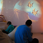 The sensory stimulations room at the Domus Laetitiae Social Cooperative, in Biella, that takes care of disabled people. . They are using image projectors, light beams, screens, sounds, flavors, fragrances, natural materials.