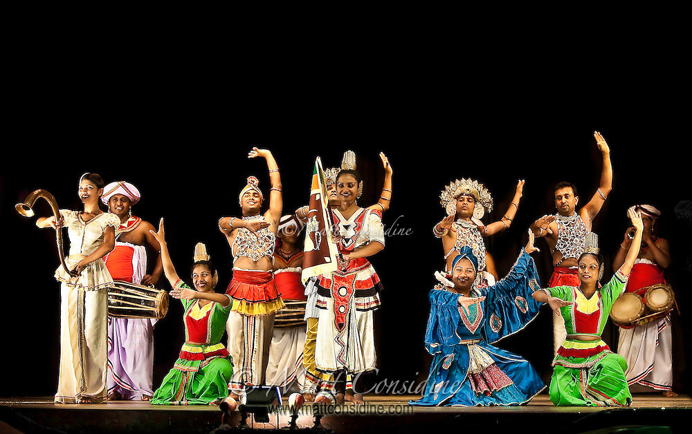 Taking a bow after a great performance of song and dance in front of an appreciative audience.<br /> (Photo by Matt Considine - Images of Asia Collection)