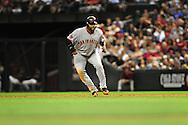 June 14 2011; Phoenix, AZ, USA; San Francisco Giants base runner Pablo Sandoval (48) leads off first base during the fifth inning against the Arizona Diamondbacks at Chase Field. Mandatory Credit: Jennifer Stewart-US PRESSWIRE..