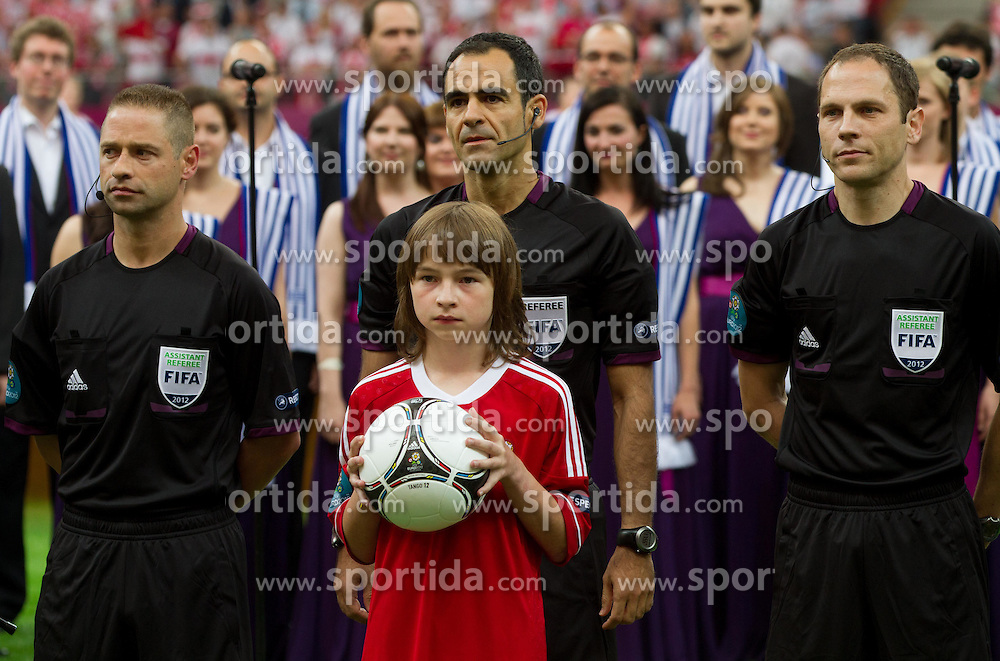 Assistant referee Roberto Alonso Fernandez, Referee Carlos Velasco Carballo and assistant referee Juan Carlos Yuste Jimenez of Spain prior to the UEFA EURO 2012 group A match between Poland and Greece at The National Stadium on June 8, 2012 in Warsaw, Poland.  (Photo by Vid Ponikvar / Sportida.com)