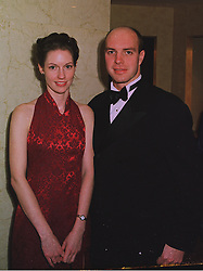 Olympic swimming gold medalist in 1988 ADRIAN MOOREHOUSE and MISS LIZ SMITH, at a ball in London on 17th December 1997.MEG 7