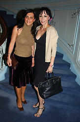 Left to right, ELLA KRASNER and MARIE HELVIN at jewellers Tiffany's Christmas party held at The Savile Club, 69 Brook Street, London on 14th December 2004.<br />