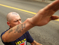 COEUR D ALENE, ID - JULY 17:  Jerald O'Brien gives a salute during the World Congress Parade held in Coeur d'Alene, Idaho, on Saturday, July 17, 2004. About 40 supporters and members marched in downtown Coeur d'Alene for the Aryan World Congress. (Photo by Jerome Pollos/Getty Images)