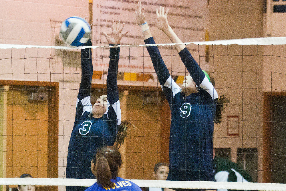 Lathan Goumas | The Bay City Times..Alex Hall(3) and Asleigh Antell(9) of Heritage High School attempt to block the ball during a quad volleyball match at Garber High School in Essexville, MI., on Thursday September 29, 2011.