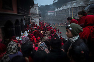 — Throngs of observers surround the area where the 200 devotees will take their morning ritual bath. Every day crowds visit the festival, offering both monetary and spiritual support for the women during their rigorous endeavor. The pilgrims and the observers are integral parts or principal players, acting out an ancient ritual or drama.