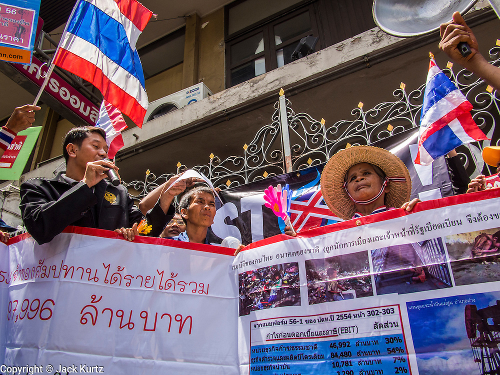 03 SEPTEMBER 2013 - BANGKOK, THAILAND: People protesting the price of cooking gas block the entrance to Government House in Bangkok. The Thai government raised the price of Liquified Propane Gas (LPG - cooking gas) by 50 satang per kilogram (about 1.5 cents US) over the weekend. The price of electricity and highway tolls also went up on the same day dealing most Thais a triple blow. The Thai consumers foundation has filed a suit in Thai administrative courts to block the increase but the courts have not yet ruled on the case. About 50 people protested the price hike at Government House in Bangkok and delivered a letter outlining their objections to a representative of the Prime Minister.      PHOTO BY JACK KURTZ