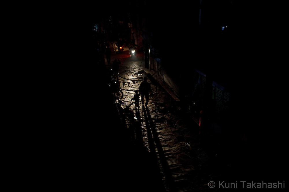 (Jan 7, 2012 - Kathmandu, Nepal).Streets are only illuminated by vehicle lights during power outage in Kathmandu, Nepal, on Jan 7, 2012. For the last several years, nearly 800,000 people of the capital city faced up to 16 hours of blackouts every day, mainly caused by political instability. Nepal is said to be second only to Brazil in terms of water resources but the government has been incapable of harnessing hydropower..(Photo by Kuni Takahashi)