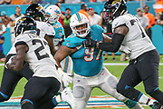Aug 22, 2019; Miami Gardens, FL USA; Miami Dolphins defensive tackle and first round draft pick Christian Wilkins (97) breaks through the Jacksonville offensive line during an NFL preseason game at Hard Rock Stadium. The Dolphins beat the Jaguars 22-7. (Kim Hukari/Image of Sport)