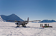 A Twin Otter aeroplane refuels before departure during a British mountaineering expedition to Knud Rasmussens Land, East Greenland, Arctic, 2006.