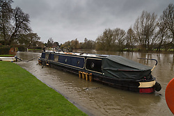 A narrowboat's mooring bollards are submerged beneath the waters of the fast flowing Thames at Wargrave in Berkshire as heavy rains in the River Thames catchment area and saturated ground causes the river to rise to within inches of bursting its banks.. April 02 2018.