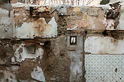 A wall of an abandoned  building damaged by the earthquake in the historical center city. On 6 April 2009 a strong earthquake hit the city of L'Aquila, in the central Abruzzo region of Italy, leaving 308 dead and tens of thousand homeless. 4  years after In the historical center of the city few signs of reconstructions could be seen. On the other hand the effects of the of abandonment add up to the destruction of the quake. .